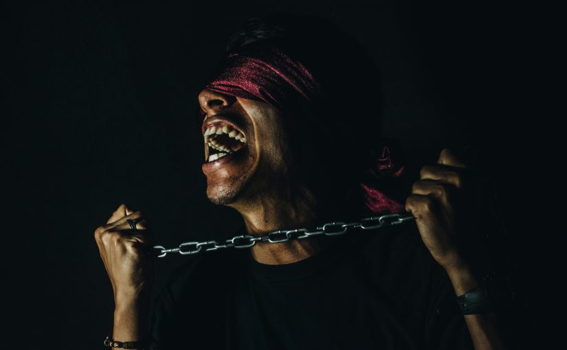 The Cancer Voice Asia | A man shouting for a freedom from pain. Photo courtesy by Tony Rojas on Unsplash